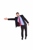 Serious businessman in suit gesturing with hand Royalty Free Stock Image