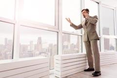 Serious businessman talking on mobile phone Stock Photo