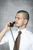 Serious businessman talking on the phone Stock Photo