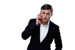 Serious businessman talking on the phone Royalty Free Stock Image