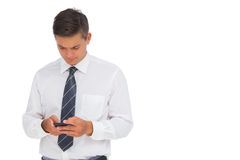 Serious businessman texting Royalty Free Stock Photos