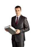 Serious businessman with thick folder Stock Photography