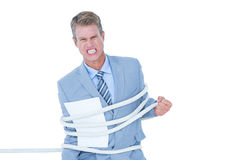 Serious businessman tied up at work Stock Photos