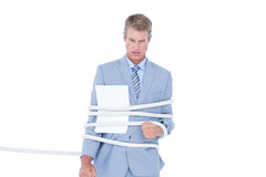 Serious businessman tied up at work Royalty Free Stock Image