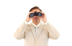 Serious businessman using binoculars Stock Photos