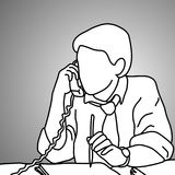 Serious businessman using desk telephone with a pencil on his le Stock Photo
