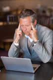 Serious businessman using his laptop Royalty Free Stock Photo