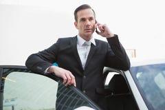 Serious businessman using his phone Stock Photo