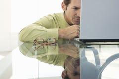 Serious Businessman Using Laptop Royalty Free Stock Image