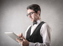 Serious businessman using a tablet Royalty Free Stock Photo