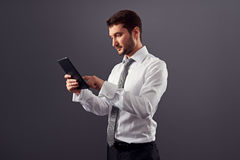 Businessman using tablet pc Stock Image