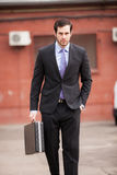 Serious businessman walking on the street Royalty Free Stock Photo