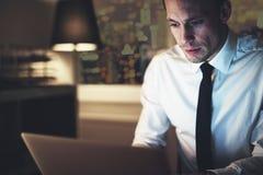 Serious businessman working on laptop Stock Photo