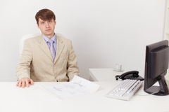 Serious businessman on workplace at office Royalty Free Stock Image