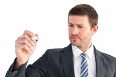 Serious businessman writing with marker Royalty Free Stock Photography