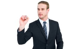 Serious businessman writing with marker Royalty Free Stock Image