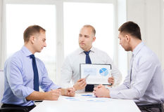 Serious businessmen with papers in office Stock Photo