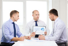 Serious businessmen with papers in office Royalty Free Stock Images