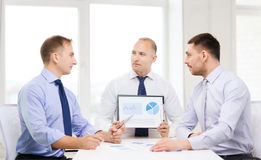 Serious businessmen with papers in office Stock Photos