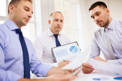 Serious businessmen with papers in office Royalty Free Stock Photo