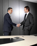 Serious businessmen shaking hands Stock Photo