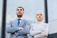 Serious businessmen standing over office building Royalty Free Stock Photos