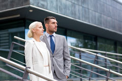Serious businessmen standing over office building Royalty Free Stock Image