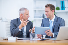 Serious businessmen working together on digital tablet Royalty Free Stock Image