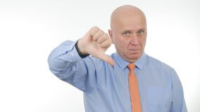 Serious Businessperson Make Dislike Hand Gestures royalty free stock photo