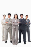 Serious businessteam standing with arms folded Stock Image