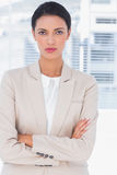 Serious businesswoman with arms crossed Stock Image
