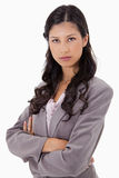 Serious businesswoman with arms folded Royalty Free Stock Photos