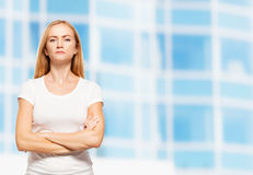 Serious businesswoman on the background of glass office building Royalty Free Stock Photo