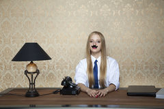 Serious businesswoman behind the desk. Serious business woman behind the desk royalty free stock photos
