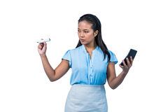 Serious businesswoman with calculator writing with pen Stock Photos