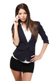 Serious businesswoman with cellphone Stock Images