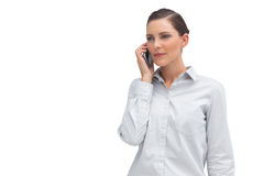 Serious businesswoman with cellphone Royalty Free Stock Photos