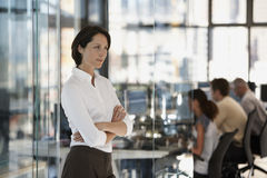 Serious Businesswoman With Colleagues In Background Royalty Free Stock Photography