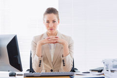 Serious businesswoman with computer at office desk Royalty Free Stock Photos