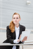 Serious Businesswoman With Digital Tablet Royalty Free Stock Images