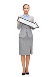 Serious businesswoman with direction arrow sign Royalty Free Stock Photo