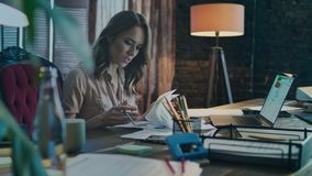 Serious businesswoman doing business data analysis. Working woman at workplace. Serious businesswoman doing business data analysis. Working woman analyzing stock video footage