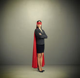 Serious businesswoman dressed as a superhero Stock Image