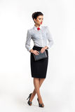 Serious businesswoman - fashion model with notepad Royalty Free Stock Image