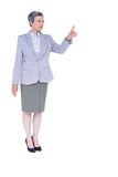 A serious businesswoman with grey hair gesturing Royalty Free Stock Photography