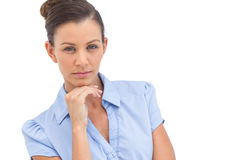 Serious businesswoman with hand on chin Royalty Free Stock Photo