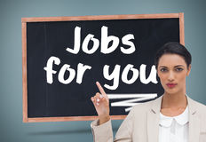 Serious businesswoman with hands up Stock Photos