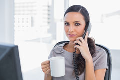 Serious businesswoman having a break Stock Photo