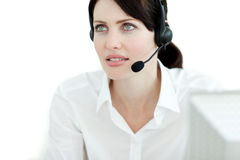 Serious businesswoman with headset on Royalty Free Stock Images