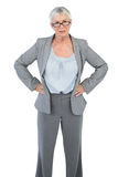 Serious businesswoman with her hands on hips Stock Photos